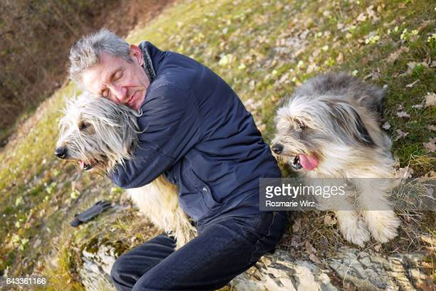 senior man with his two dogs - hairy old man stock pictures, royalty-free photos & images