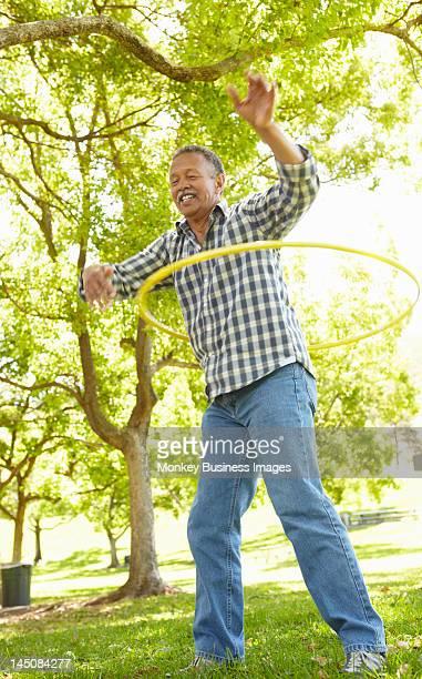 Senior  man with hula-hoop