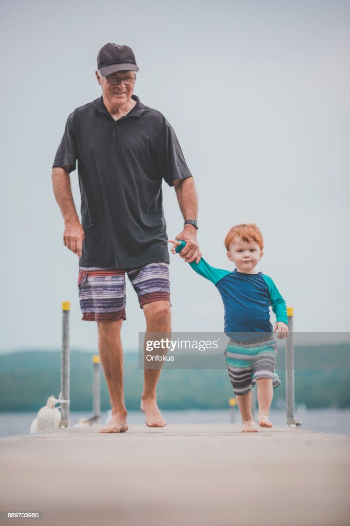 Senior Man with little boy at the lake, summer day : Stock Photo