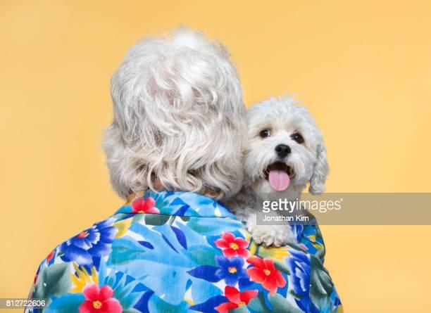 Senior man with look alike dog.