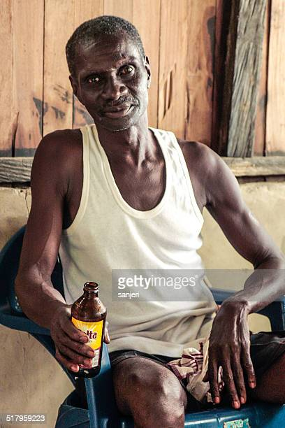Senior man with malt - Africa, Ghana