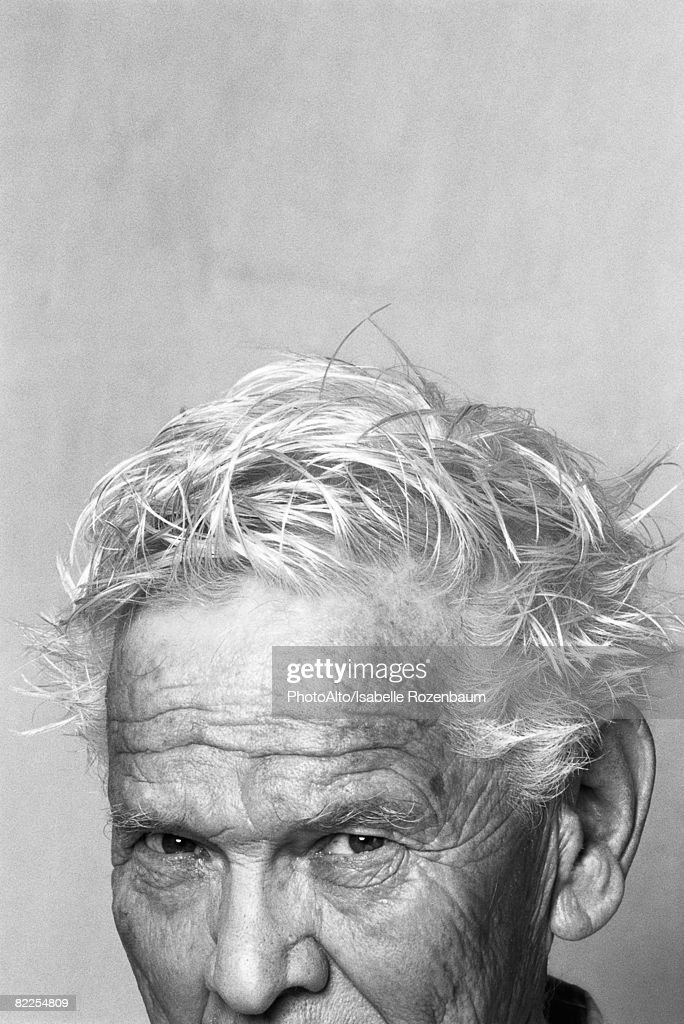 Senior man with messy hair, portrait, cropped : Stock Photo