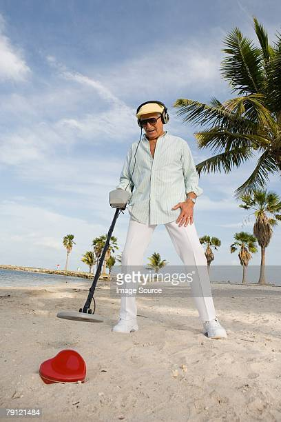 senior man with metal detector - metal detector stock photos and pictures