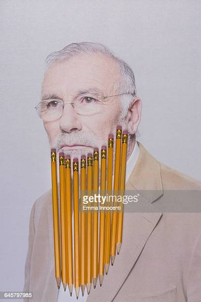 Senior man with pencils for a beard