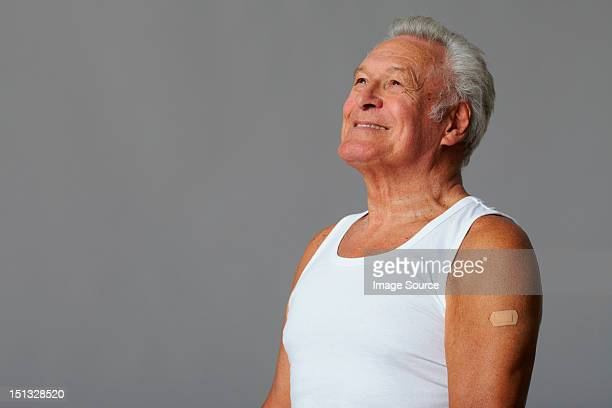Senior man with plaster on arm