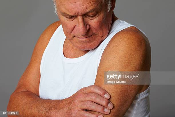 senior man with plaster on arm - arm stock pictures, royalty-free photos & images