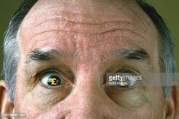 senior man with pound symbols in eyes, close-up (digital composite) - balding stock pictures, royalty-free photos & images
