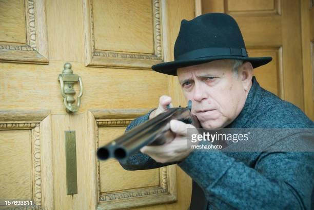 Senior Man With Shotgun