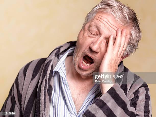 senior man with sleep apnoea - yawning stock pictures, royalty-free photos & images
