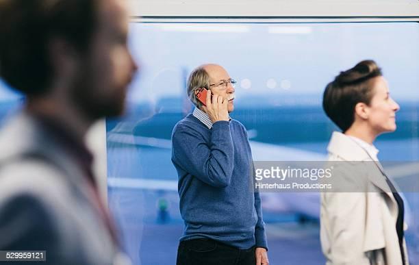 Senior Man With Smart Phone At Airport
