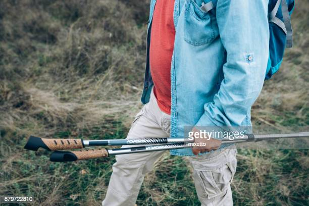 Senior man with sticks for hiking