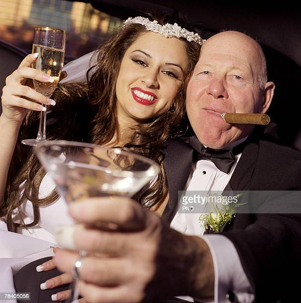 Senior man with young bride