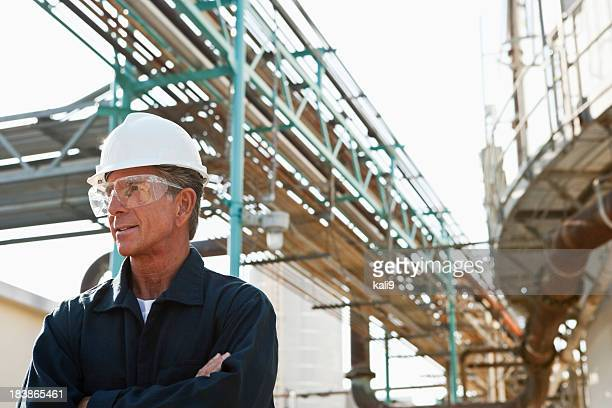 Senior man working as an engineer at an industrial plant
