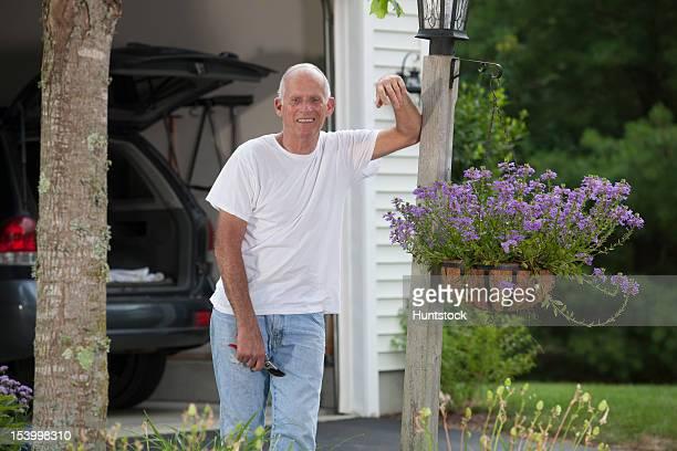 Senior man working in his flower garden