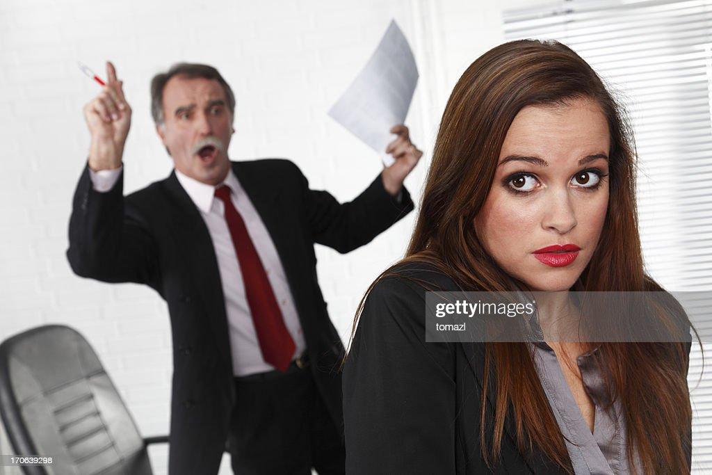 Senior manager angry at secretary : Stock Photo