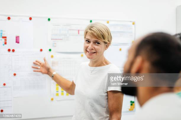 a senior manager discussing timetable in factory office - employee engagement stock pictures, royalty-free photos & images