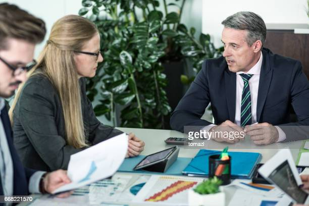 senior manager in meeting - assertiveness stock pictures, royalty-free photos & images
