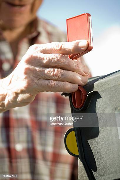 a senior man's hand opening the mailbox - domestic mailbox stock pictures, royalty-free photos & images