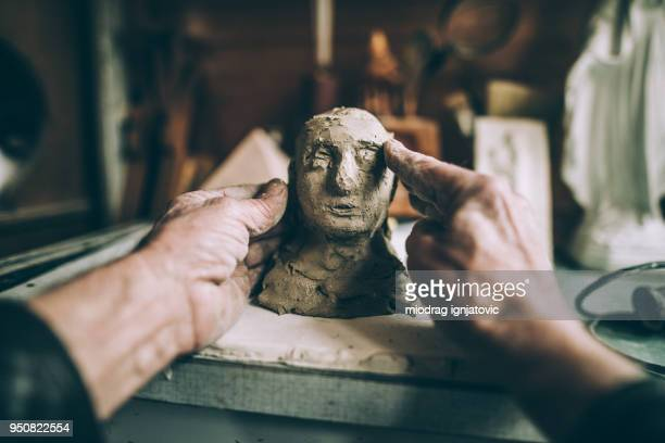 senior man's hands making statue of clay - sculptor stock pictures, royalty-free photos & images
