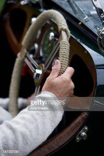 senior mans hands  steering wheel  car stock photo
