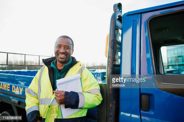 senior manual worker and his van - routine stock pictures, royalty-free photos & images