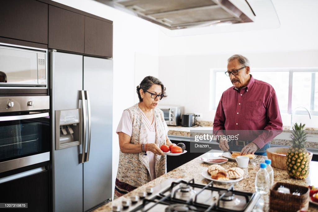 Senior married couple eating healthy food for breakfast. : Stock Photo