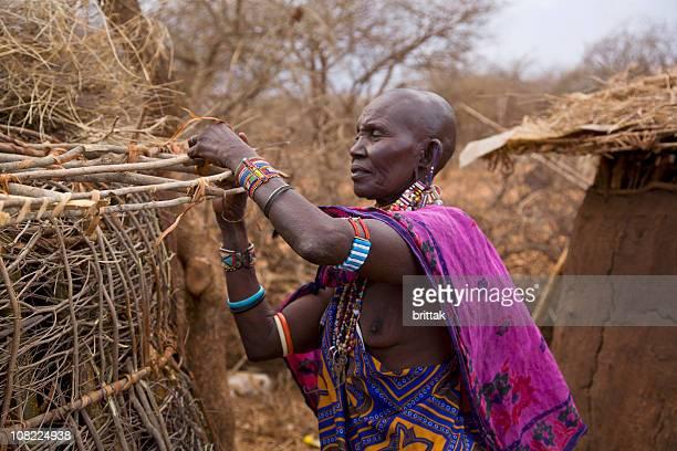Senior Masai Woman Building Mudhouse