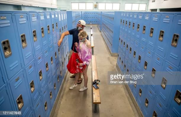 Senior Mason Wise left helps his sister Mackenzie a sophomore clean out her PE locker at El Camino Real Charter High School on Thursday April 30 2020...