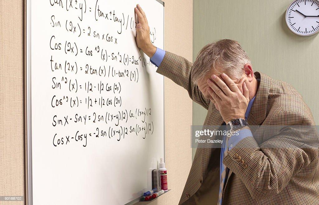 Senior maths teacher suffering emotional stress. : Stock Photo