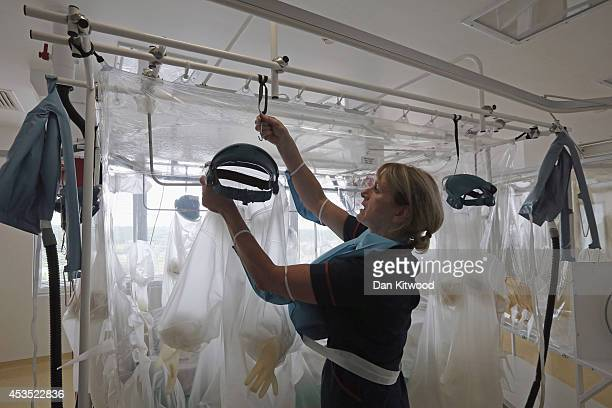 Senior Matron Breda Athan demonstrates the procedure when preparing to treat potential patients with Ebola on August 12 2014 in London England The...