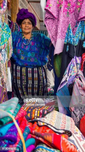 Senior mayan woman selling handmade textiles and souvenirs, Panajachel, Guatemala