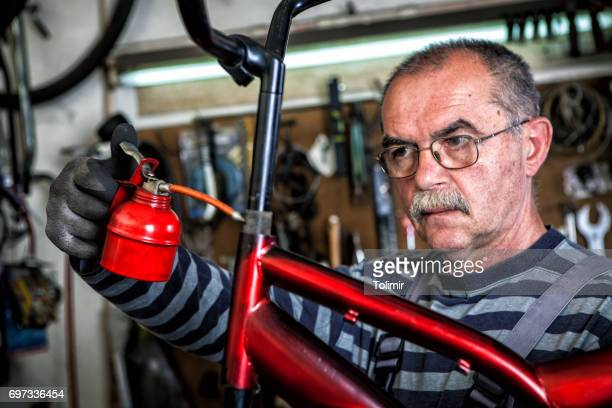 Senior mechanic in his factory