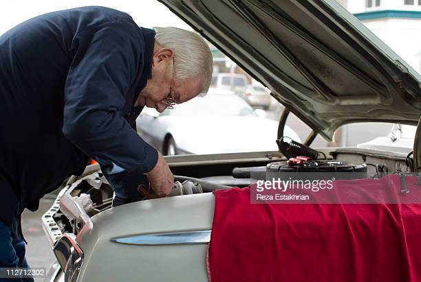 Senior mechanic repairs auto
