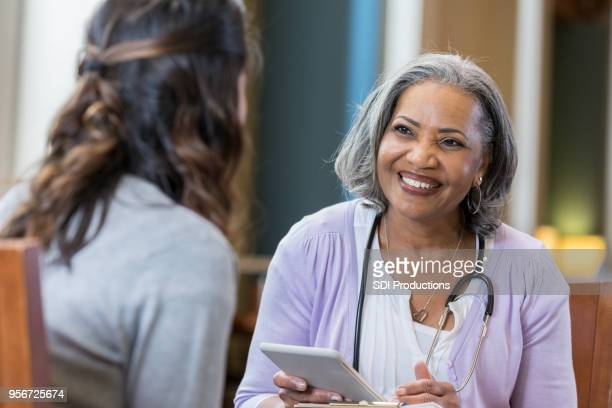 Senior medical professional interviews potential new hire
