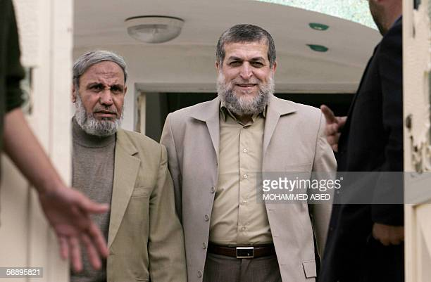 Senior member of the Radical Islamic Jihad movement Nafez Azam walks out with Hamas leader and MP Mahmud alZahar following their meeting in Gaza City...