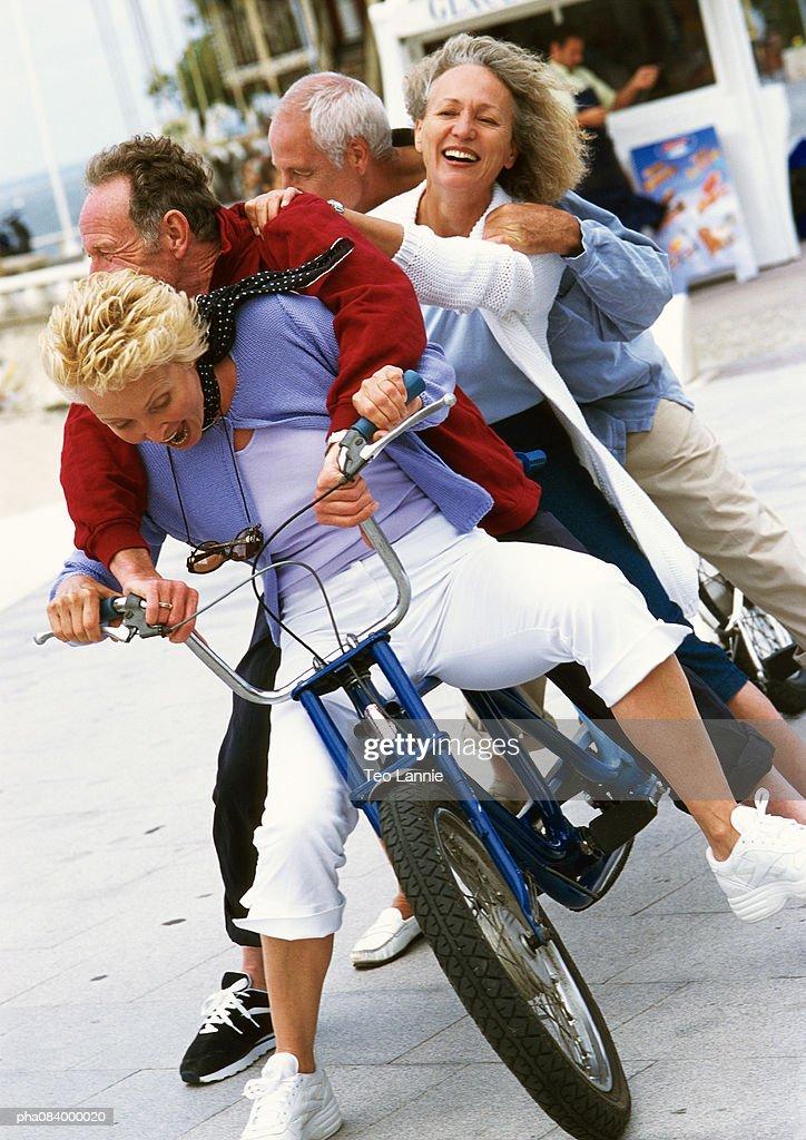 Senior men and women on tandem bike, portrait. : Stockfoto