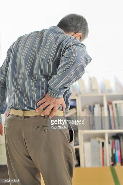 senior men are in pain lower back pain - 下背部 ストックフォトと画像
