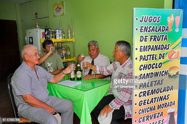 Senior men drinking beer in a family restaurant in Calle 2 de Mayo
