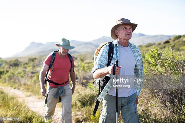 senior men exercising outdoors - hiking pole stock pictures, royalty-free photos & images