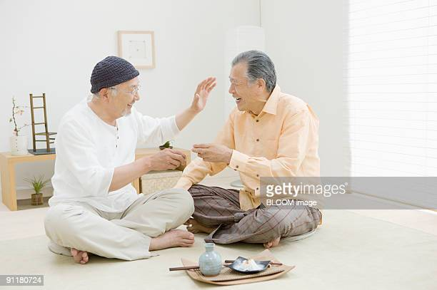 Senior men having sake
