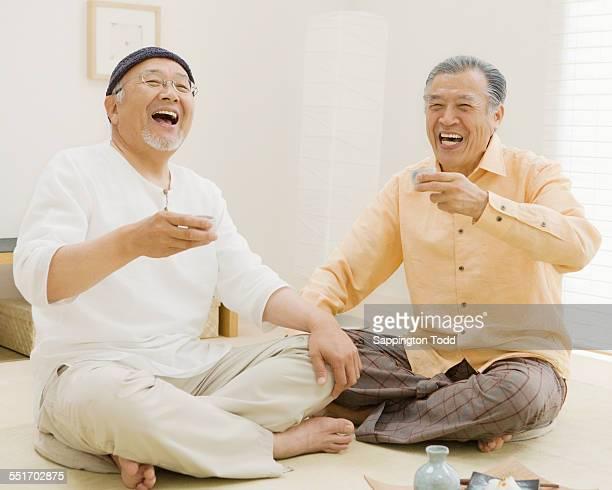 Senior Men Holding Sake Cup