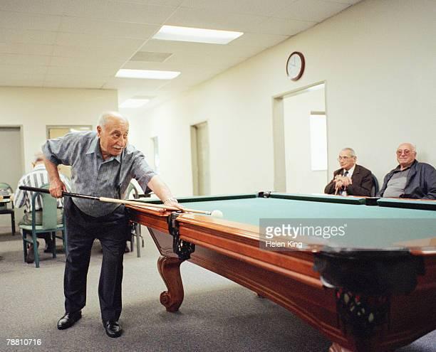senior men playing billiards - old men playing pool stock pictures, royalty-free photos & images