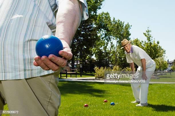 Senior men playing bocce