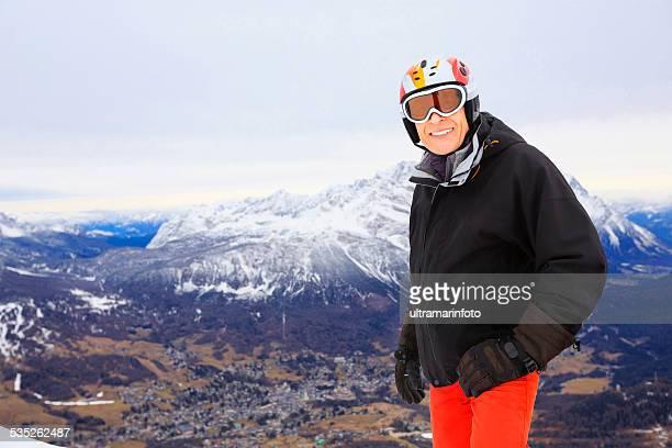 senior men snow skier resting, enjoying on cortina ski resorts - ski wear stock pictures, royalty-free photos & images
