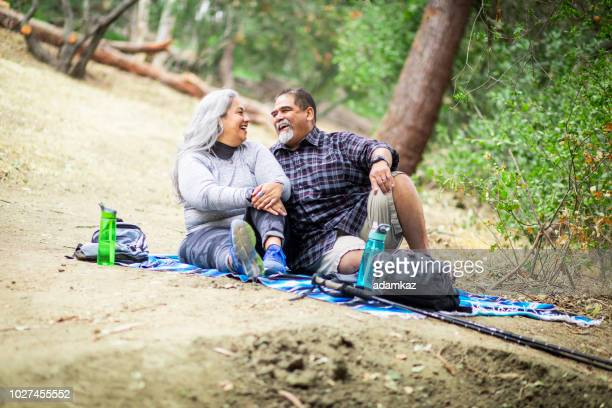 senior mexican couple having a picnic - mexican picnic stock pictures, royalty-free photos & images