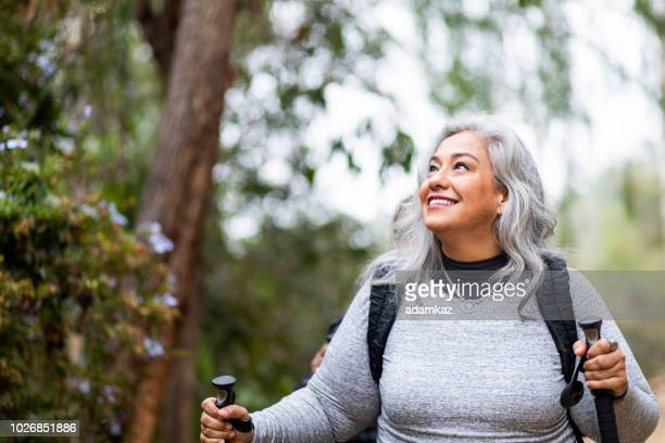 senior mexican couple hiking - backpacker stock pictures, royalty-free photos & images