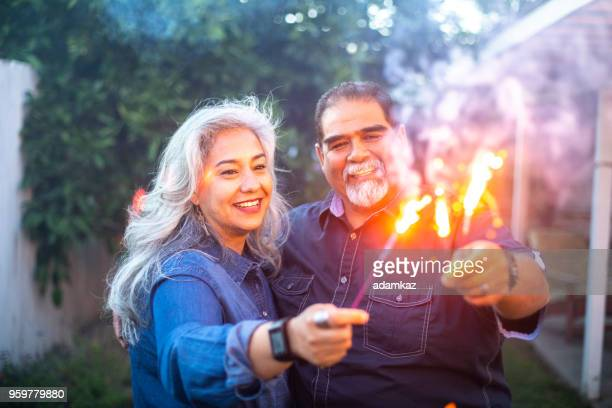 Senior Mexican Couple holding Sparklers Together