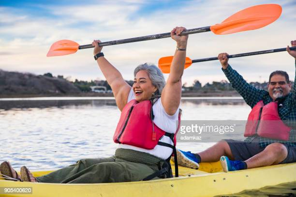 Senior Mexican Couple Kayaking Celebrating