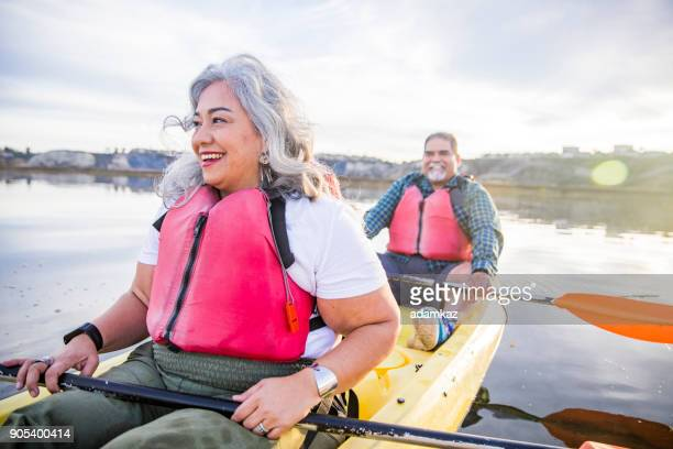 senior mexican couple kayaking - health insurance stock pictures, royalty-free photos & images