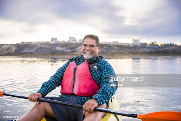 senior mexican couple kayaking - fat guy on beach stock pictures, royalty-free photos & images